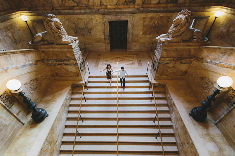 boston public library couple running down stairs